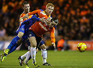 Luke Rooney of Luton Town (right) is challenged by Ryan Woods of Shrewsbury Town during the Sky Bet League 2 match at Kenilworth Road, Luton<br /> Picture by David Horn/Focus Images Ltd +44 7545 970036<br /> 08/01/2015