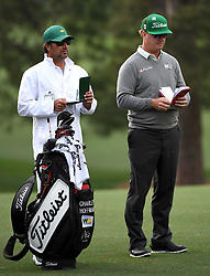 April 6, 2017 - Augusta, GA, USA - Caddie Brett Waldman, left, and golfer Charley Hoffman, right, look over their yardage books along the 17th fairway during first-round action of the Masters Tournament at Augusta National Golf Club on Thursday, April 6, 2017, in Augusta, Ga. Hoffman finished the round at -7. (Credit Image: © Jeff Siner/TNS via ZUMA Wire)