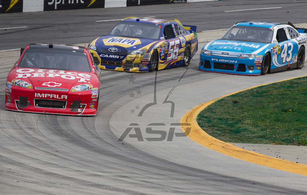 Martinsville, VA - MAR 01, 2012:  Tony Stewart (14) races for position during the Goody's Fast Relief 500 race at the Martinsville Speedway in Martinsville, VA.