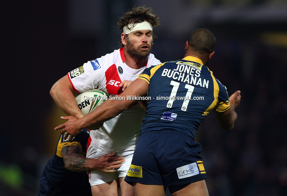 PICTURE BY VAUGHN RIDLEY/SWPIX.COM - Rugby League - Super League - Leeds Rhinos v St Helens Saints - Headingley, Leeds, England - 21/05/12 - St Helens Josh Perry is tackled by Leeds Brent Webb and Jamie Jones-Buchanan.