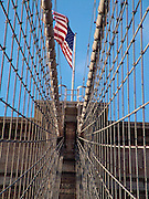 American flag on top of the Brooklyn Bridge in New York City USA.