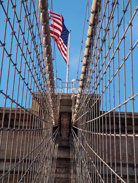 American flag on top of the Brooklyn Bridge in New York City USA.