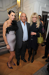 Left to right, ASSIA WEBSTER, SIR PHILIP GREEN and JO WOOD at a party to launch the Georgina Chapman collection for Garrard held at Garrard, Albermarle Street, London on 4th November 2009.