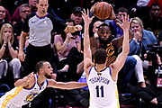 Jun 6, 2018; Cleveland, OH, USA; Cleveland Cavaliers forward LeBron James (23) passes the ball against Golden State Warriors guard Klay Thompson (11) and guard Stephen Curry (30) during the third quarter in game three of the 2018 NBA Finals at Quicken Loans Arena.