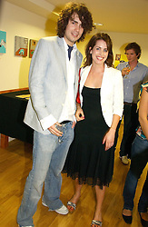 RUPERT HUMPHRIES and HOLLY WHITE at an exhibition of art by Oscar Humphries entitles 'Post-Nuclear Family' held at Nutters, Lower Ground, 12 Savile Row, London on 8th June 2006.<br />