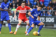 Middlesbrough midfielder Stewart Downing (19) holds up Cardiff City midfielder Marko Grujic (24) 0-0 during the EFL Sky Bet Championship match between Cardiff City and Middlesbrough at the Cardiff City Stadium, Cardiff, Wales on 17 February 2018. Picture by Alan Franklin.