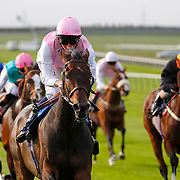 Caucus and William Buick winning the 4.15 race