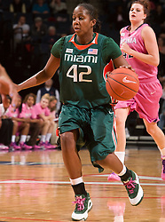 Miami (FL) forward Shenise Johnson (42) in action against UVA.  The #21 ranked Virginia Cavaliers defeated the Miami Hurricanes 85-74 in overtime at the John Paul Jones Arena in Charlottesville, VA on February 19, 2009.