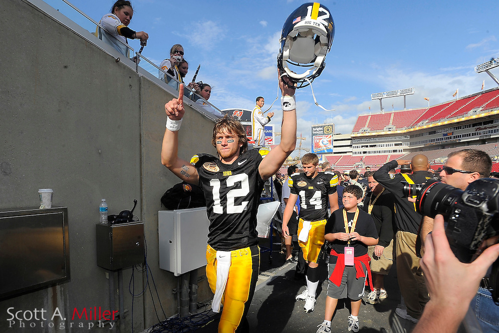 Jan 1, 2009; Tampa, FL, USA; Iowa Hawkeyes quarterback Richard Stanzi (12) celebrates as he leaves the field following Iowa's 31-10 win over the South Carolina Gamecocks at the Outback Bowl at the Raymond James Stadium.  ©2009 Scott A. Miller