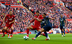 LIVERPOOL, ENGLAND - Sunday, October 7, 2018: Liverpool's Joe Gomez (L) challenges Manchester City's Raheem Sterling during the FA Premier League match between Liverpool FC and Manchester City FC at Anfield. (Pic by David Rawcliffe/Propaganda)