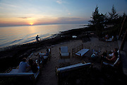 Phu Quoc Island. Ong Lang Beach. Mango Bay Resort. Guests enjoying sunset at the beachfront restaurant.