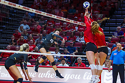 BLOOMINGTON, IL - September 14: Kristina Fisher strikes towards Sydney Holt during a college Women's volleyball match between the ISU Redbirds and the University of Central Florida (UCF) Knights on September 14 2019 at Illinois State University in Normal, IL. (Photo by Alan Look) Official in background - Dean Hoskin