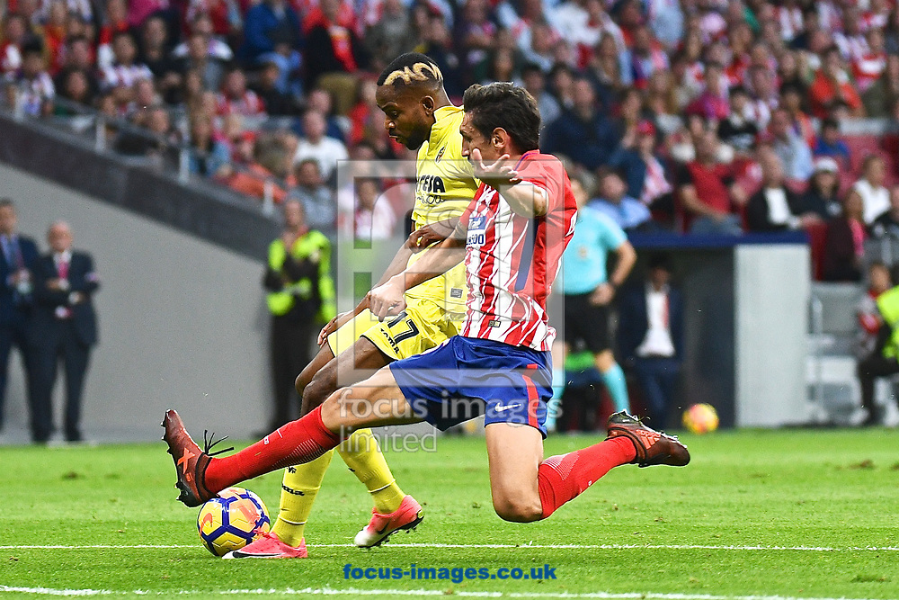 C&eacute;dric Bakambu of Villareal is tackled by Stefan Savić of Atletico Madrid during the La Liga match at the Wanda Metropolitano Stadium, Madrid<br /> Picture by Kristian Kane/Focus Images Ltd +44 7814 482222<br /> 28/10/2017