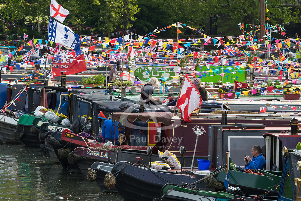Little Venice, London, April 30th 2017. Narrowboaters from all over the uK gather for the annual Canalway Cavalcade, held on the May Day Bank holiday weekend, organised by the Inland Waterways Association, where boaters get the chance to display their immaculately prepared and brightly painted craft as well as compete in various manoeuvring tests. PICTURED: Narrowboats moored in the sunshine where the Regents Canal becomes the Grand Union Canal.<br /> Credit: ©Paul Davey<br /> To licence contact: <br /> Mobile: +44 (0) 7966 016 296<br /> Email: paul@pauldaveycreative.co.uk<br /> Twitter: @pauldaveycreate