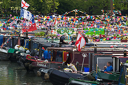 Little Venice, London, April 30th 2017. Narrowboaters from all over the uK gather for the annual Canalway Cavalcade, held on the May Day Bank holiday weekend, organised by the Inland Waterways Association, where boaters get the chance to display their immaculately prepared and brightly painted craft as well as compete in various manoeuvring tests. PICTURED: Narrowboats moored in the sunshine where the Regents Canal becomes the Grand Union Canal.<br /> Credit: &copy;Paul Davey<br /> To licence contact: <br /> Mobile: +44 (0) 7966 016 296<br /> Email: paul@pauldaveycreative.co.uk<br /> Twitter: @pauldaveycreate