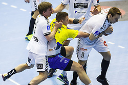 Poteko Vid #15 of RK Celje Pivovarna Lasko and Moen Nilsen Stig Tore #9 of IFK Kristianstad   with S?rensen Tim D. #7 of IFK Kristianstad during handball match between RK Celje Pivovarna Lasko (SLO) and IFK Kristianstad (SWE) in Group phase of EHF Men's Champions League 2016/17, on February 11, 2017 in Arena Zlatorog, Celje, Slovenia. Photo by Grega Valancic