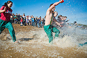 Ohio University students run into the cold water during the sixth-annual Polar Bear Plunge held at Lake Snowden in Albany, Ohio. The charity event held by the Ohio University Police Department and Phi Kappa Theta Fraternity raised money for Special Olympics Ohio, to raise money and awareness for individuals with intellectual disabilities.