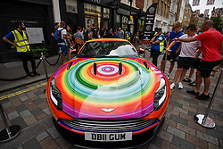 © Licensed to London News Pictures. 04/08/2018. LONDON, UK. An Aston Martin DB11 parked up in Covent Garden for Gumball 3000, a charity race for supercars and more.  150 cars will journey from London to Tokyo in a race which commences on Sunday 5 August.  Photo credit: Stephen Chung/LNP