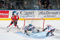 KELOWNA, CANADA - JANUARY 28: Joachim Blichfeld #20 of the Portland Winterhawks skates behind the net with the puck while Lucas Johansen #7 and Michael Herringer #30 of the Kelowna Rockets block the shot on January 28, 2017 at Prospera Place in Kelowna, British Columbia, Canada.  (Photo by Marissa Baecker/Shoot the Breeze)  *** Local Caption ***
