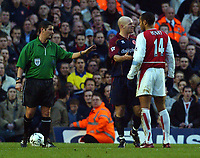 Referee Mr Andy D'Urso steps in between Thierry Henry (Arsenal) and Danny Mills (Middlesbrough) Arsenal v Middlesbrough, Highbury, 10/01/2003, Premiership Football. Credit : Colorsport / Robin Hume. Digital File Only.