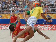 Football-FIFA Beach Soccer World Cup 2006 - Semi-final -BRA_POR -Buru-BRA-saves the overhead kick of Bechior-POR - Rio de Janeiro - Brazil 11/11/2006<br />Mandatory credit: FIFA/ Marco Antonio Rezende.