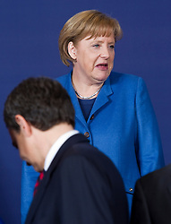 Angela Merkel, Germany's chancellor, arrives for the family photo, during the European Summit, in Brussels, on Thursday, March 25, 2010. (Photo © Jock Fistick)