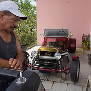 SEPTEMBER 25 - CANOVANAS, PUERTO RICO - <br /> Jose Torres's stands by his 1920s hot rod in his San Isidro neighborhood home. During the path of Hurricane Maria, Torres, a boxing instructor, saw his car go under seven feet of water . He is a diabetic and lost all his medications when his two story house was flooded up to seven feet. <br /> (Photo by Angel Valentin for NPR)