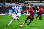 Eric Durm of Huddersfield Town (37) and Nathan Redmond of Southampton (22) come together during the Premier League match between Huddersfield Town and Southampton at the John Smiths Stadium, Huddersfield, England on 22 December 2018.