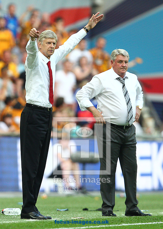 Ars&egrave;ne Wenger, Manager of Arsenal and Steve Bruce, Manager of Hull City during the The FA Cup Final match at Wembley Stadium, London<br /> Picture by Paul Terry/Focus Images Ltd +44 7545 642257<br /> 17/05/2014