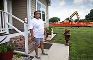 Melinda Tillies watching the installation of the Bayou Bridge Pipeline next to her home in Youngsville, Louisiana. The pipeline was installed about 25 feet from her home on her neighbors land.  There are no federal rules about how close a pipeline can be built next to a home.