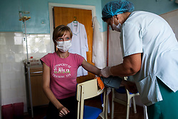 A young TB patient receives a shot at the TB hospital in Balti.