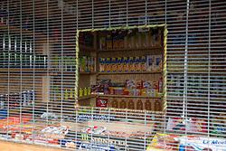 """Calais, Pas-de-Calais, France - 16.10.2016    <br />     <br />  Some refugees open small shops and restaurants inside the camp. """"Jungle"""" refugee camp on the outskirts of the French city of Calais. Many thousands of migrants and refugees are waiting in some cases for years in the port city in the hope of being able to cross the English Channel to Britain. French authorities announced that they will shortly evict the camp where currently up to up to 10,000 people live.<br /> <br /> Einige Fluechtlinge eroeffneten kleine Geschaefte und Restaurants in dem Camp. """"Jungle"""" Fluechtlingscamp am Rande der franzoesischen Stadt Calais. Viele tausend Migranten und Fluechtlinge harren teilweise seit Jahren in der Hafenstadt aus in der Hoffnung den Aermelkanal nach Großbritannien ueberqueren zu koennen. Die franzoesischen Behoerden kuendigten an, dass sie das Camp, indem derzeit bis zu bis zu 10.000 Menschen leben Kürze raeumen werden. <br /> <br /> Photo: Bjoern Kietzmann"""