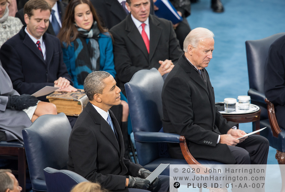 President Obama and Vice President Biden listen to remarks at the beginning of the 57th Presidential Inauguration of President Barack Obama at the U.S. Capitol Building in Washington, DC January 21, 2013.