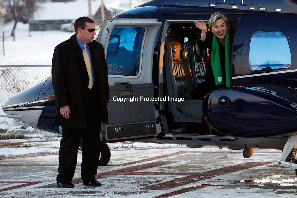 U.S. Democratic Presidential candidate Senator Hillary Clinton (D-NY) gives the thumbs up as a campaign helicopter gets ready to take her away from a field December 16, 2007 in Dunlap, Iowa. Clinton is campaigning in Iowa, beginning her 'Every County Counts Tour' ahead of the January 3 caucus.