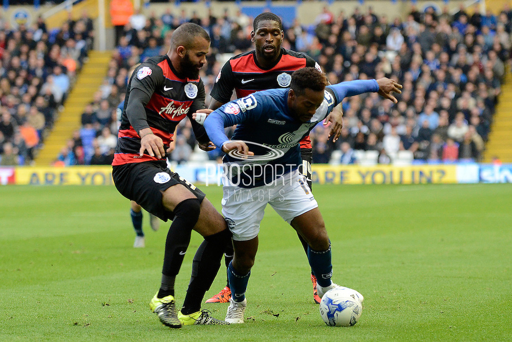 Queens Park Rangers midfielder Sandro tracks Birmingham City midfielder Jacques Maghoma during the Sky Bet Championship match between Birmingham City and Queens Park Rangers at St Andrews, Birmingham, England on 17 October 2015. Photo by Alan Franklin.