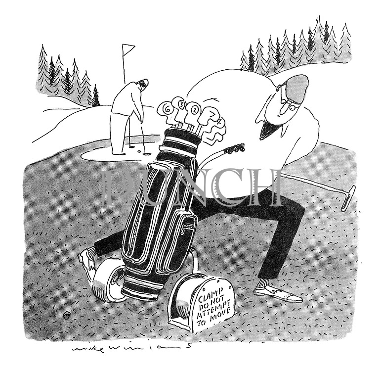 A golfer discovers his golf bag trolley has been clamped)