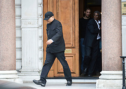 © licensed to London News Pictures.  29/07/2011. London, UK. An unidentified man appearing hiding his face leaving the Libyan Embassy today (29/07/2011). Today is the deadline for the charges d'affaires, the most senior Libyan representative in the UK, to leave the country. Britain has granted political recognition to the Libyan opposition the deadline for the Charges. Photo credit: Ben Cawthra/LNP