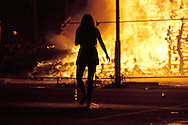 A young girl wanders in front of the raging bonfire at the top of Sandy Row, Belfast 11/7/12