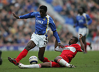 Photo: Lee Earle.<br /> Portsmouth v Middlesbrough. The Barclays Premiership. 15/04/2006. George Boateng (R) slides in on Pompey's Benjani Mwaruwari.