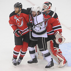 June 9, 2012: Los Angeles Kings center Mike Richards (10) battles for position in front of New Jersey Devils goalie Martin Brodeur (30) with New Jersey Devils defenseman Henrik Tallinder (7) during third period action in game 5 of the NHL Stanley Cup Final between the New Jersey Devils and the Los Angeles Kings at the Prudential Center in Newark, N.J. The Devils defeated the Kings 2-1.