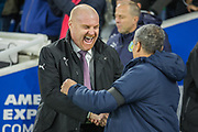 Sean Dyche, Manager of Burnley FC greeting Chris Hughton, Manager of Brighton & Hove Albion FC during the Premier League match between Brighton and Hove Albion and Burnley at the American Express Community Stadium, Brighton and Hove, England on 9 February 2019.