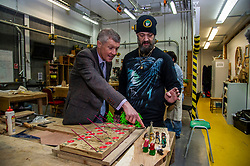 Pictured: Willie Rennie gets up close and personal with Student Robert McGee who is in the Christmas spirt early<br />