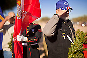09 DECEMBER 2011 - PHOENIX, AZ:  PETE LINDERT, a US Army veteran of the Vietnam War, salutes at the start of wreath laying ceremony at the National Cemetery in Phoenix. Several hundred volunteers and veterans gathered at the National Memorial Cemetery of Arizona in Phoenix Saturday to lay Christmas wreaths on headstones, a tradition started by Wreaths Across America. Wreaths Across America is a nonprofit organization founded to continue and expand the annual wreath laying ceremony at Arlington National Cemetery begun by Maine businessman, Morrill Worcester, in 1992.   PHOTO BY JACK KURTZ