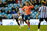 Jordan Rhodes of Sheffield Wednesday dives to head the ball in front of Gylfi Sigurðsson of Everton during the EFL Cup match between Sheffield Wednesday and Everton at Hillsborough, Sheffield, England on 24 September 2019.