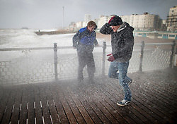 © Licensed to London News Pictures. 08/02/2016. Brighton, UK. Storm Imogen hits as waves crash onto Brighton pier soaking visitors. Photo credit: Peter Macdiarmid/LNP