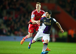 SOUTHAMPTON, ENGLAND - Saturday, March 1, 2014: Liverpool's Luis Suarez in action against Southampton's Calum Chambers during the Premiership match at St Mary's Stadium. (Pic by David Rawcliffe/Propaganda)