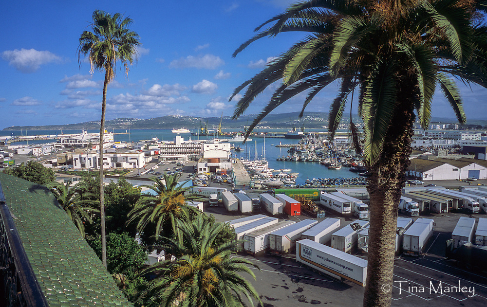 AFRICA, MOROCCO, TANGIER:  View of the port of Tangier with boats, ships, ferries, and the coast of Spain across the Strait of Gibraltar from the balcony of the Hotel Continental.