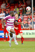 Barnet FC Striker John Akinde (9) gets a ball played in to his path during the Sky Bet League 2 match between Crawley Town and Barnet at the Checkatrade.com Stadium, Crawley, England on 7 May 2016. Photo by Andy Walter.