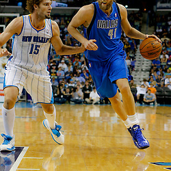 Apr 14, 2013; New Orleans, LA, USA; Dallas Mavericks power forward Dirk Nowitzki (41) drives past New Orleans Hornets center Robin Lopez (15) during the second half of a game at the New Orleans Arena. The Mavericks defeated the Hornets 107-89. Mandatory Credit: Derick E. Hingle-USA TODAY Sports