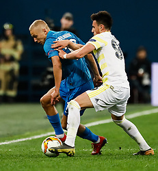 February 21, 2019 - Saint Petersburg, Russia - Igor Smolnikov (L) of FC Zenit Saint Petersburg and Elif Elmas of Fenerbahce SK vie for the ball during the UEFA Europa League Round of 32 second leg match between FC Zenit Saint Petersburg and Fenerbahce SK on February 21, 2019 at Saint Petersburg Stadium in Saint Petersburg, Russia. (Credit Image: © Mike Kireev/NurPhoto via ZUMA Press)